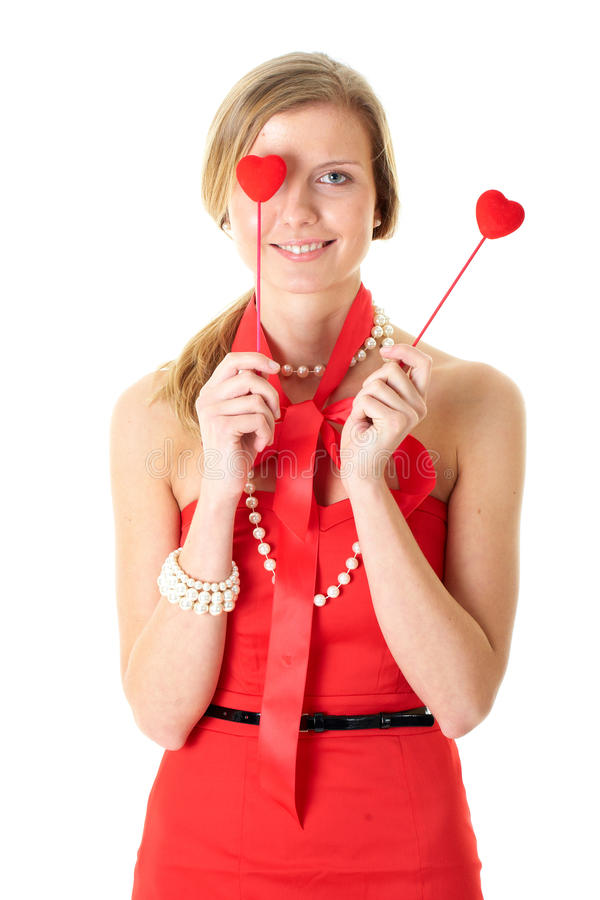 Female holds two small hearts, isolated on white stock photography