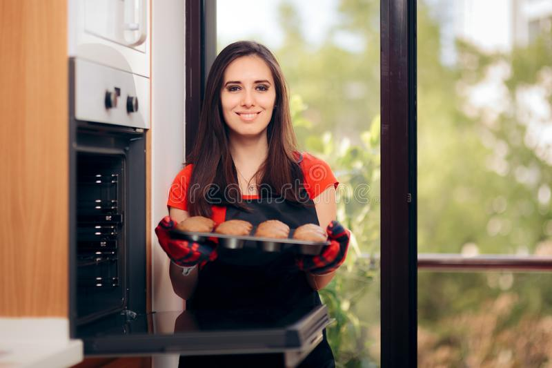 Woman Admiring her Delicious Cupcake fresh of the Oven royalty free stock images