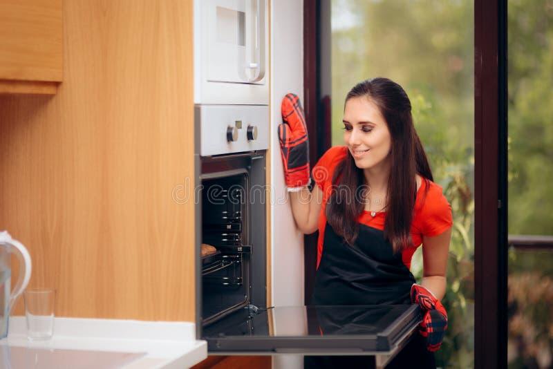 Woman Admiring her Delicious Cupcake fresh of the Oven stock photos