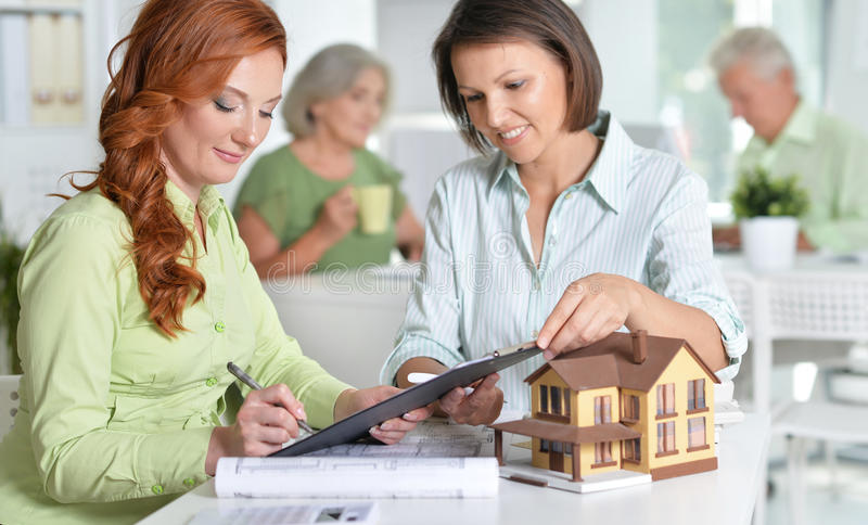 Female house agent and customer stock images