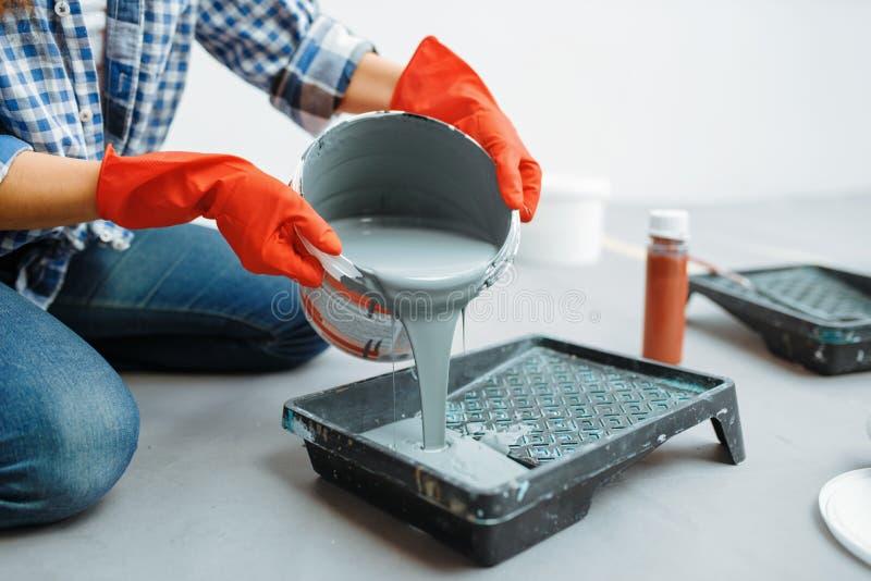 Female house painter prepares for work stock image
