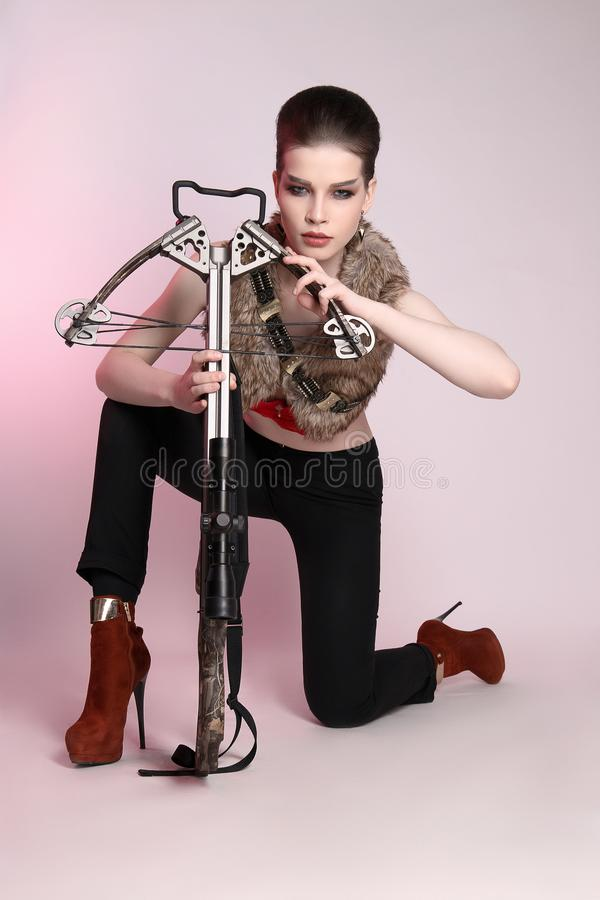 Female hunter with a crossbow stock images