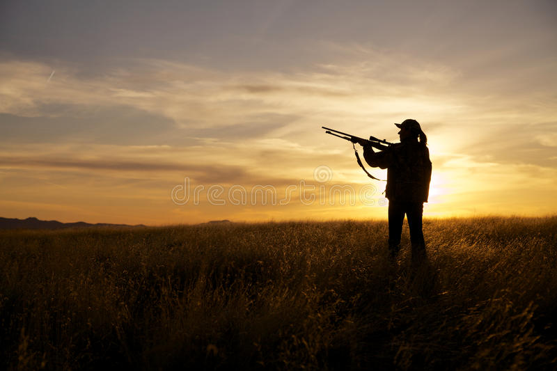 Download Female Rifle Hunter In Sunset Stock Photo - Image: 30229182