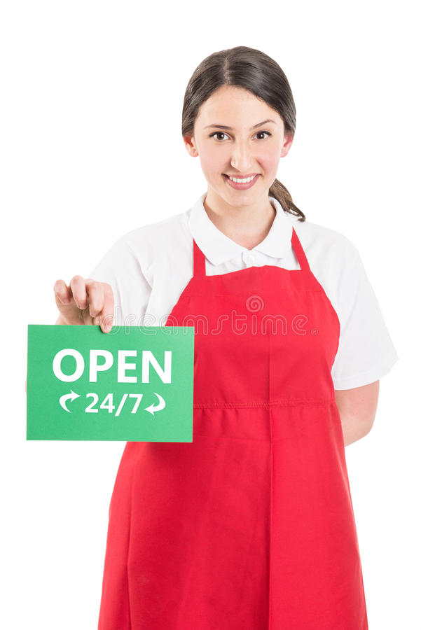 Female hypermarket worker holding open sign. Female hypermarket worker holding open 247 or nonstop sign royalty free stock photos