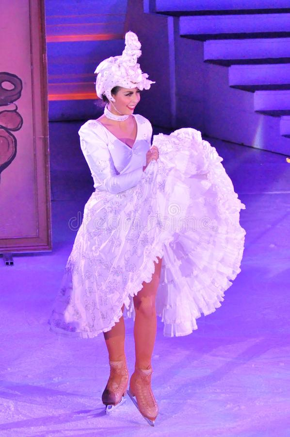 Female ice skater. Professional sportsmans ice skaters performing in an ice show production onboard cruise ship Adventure of the Seas royalty free stock photos