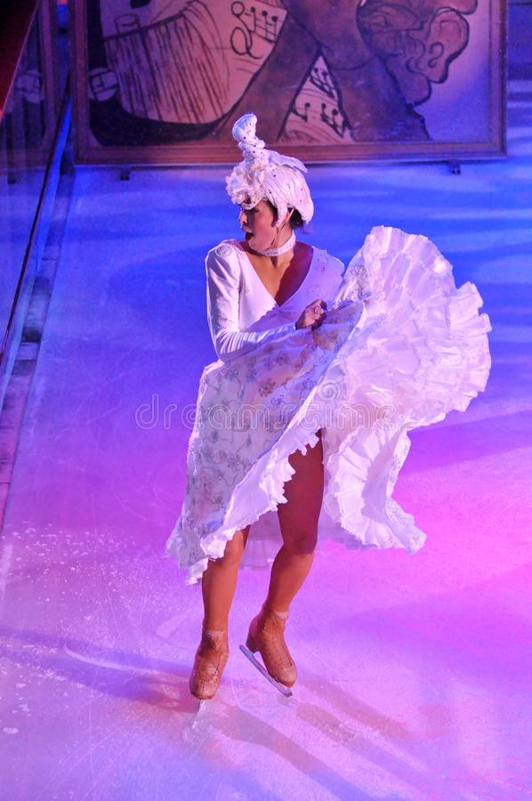 Female ice skater. Professional sportsmans ice skaters performing in an ice show production onboard cruise ship Adventure of the Seas stock images