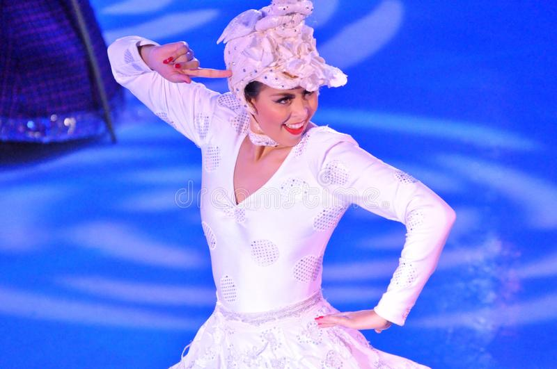 Female ice skater. Professional sportsmans ice skaters performing in an ice show production onboard cruise ship Adventure of the Seas royalty free stock photo