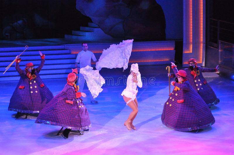 Female ice skater. Professional sportsmans ice skaters performing in an ice show production onboard cruise ship Adventure of the Seas royalty free stock image