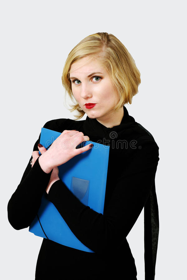 Female with important document. Sophisticated serious female holding file or important document royalty free stock images
