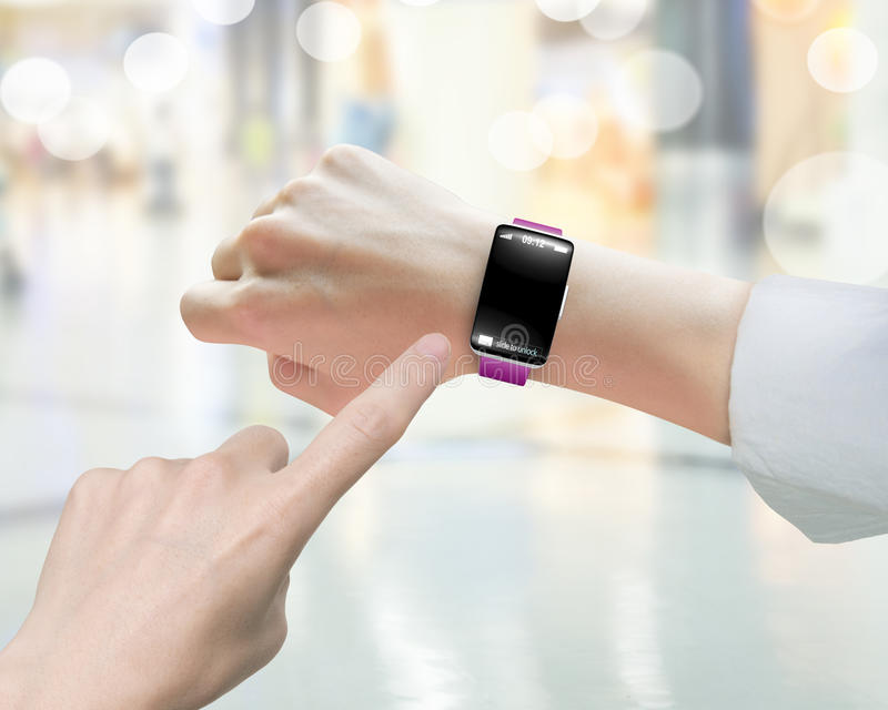 Female index finger pointing smartwatch blank black glass bent t. Female index finger pointing smart watch with blank black glass bent touchscreen, on blurred royalty free stock photos