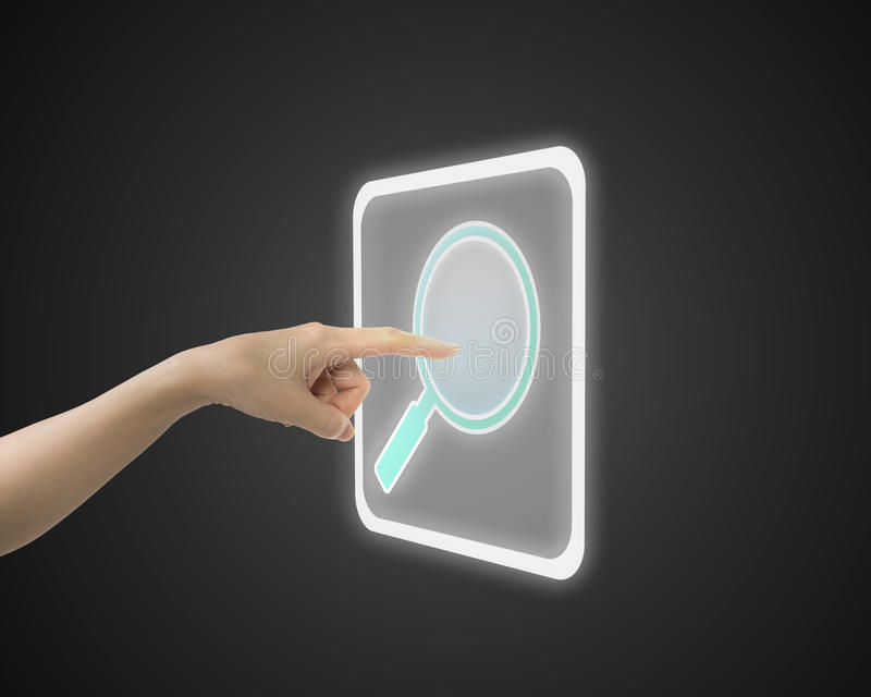 Female index finger touching search icon button. Side view royalty free stock photo