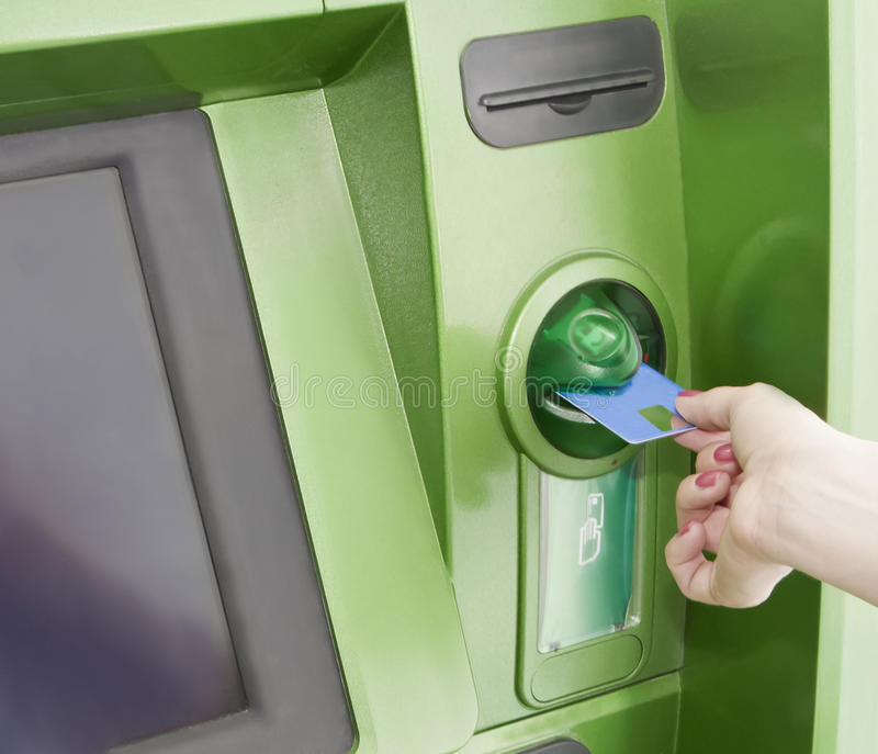 Download Female Inserts A Plastic Card In The ATM Stock Image - Image: 19938535