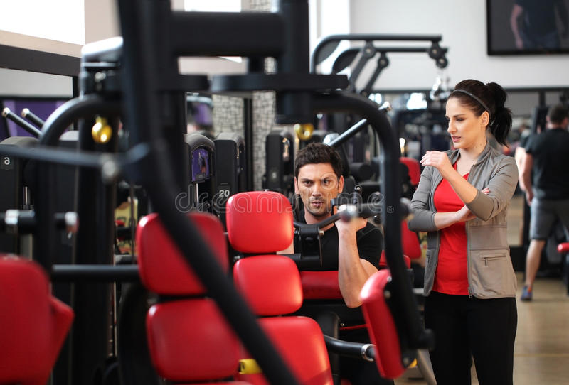 Download Female Instructor Explaining To A Man How To Workout Stock Image - Image: 40074263