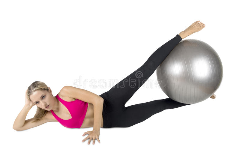 Female instructor at stretching pilates exercises with finess ba royalty free stock image