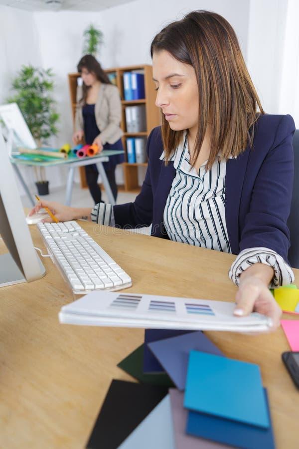 Female interior designer looking at swatches stock photos