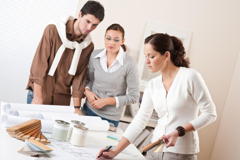 Female interior designer with two clients royalty free stock photos