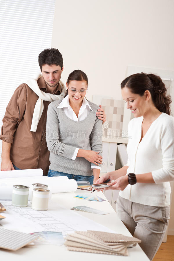 Female interior designer with two clients stock photo