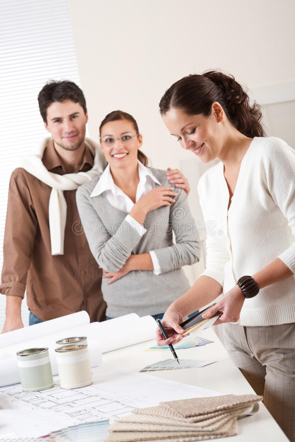 Download Female Interior Designer With Two Clients Stock Photo - Image: 11957358