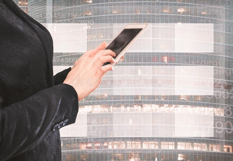 Female in jacket clicking finger. On the mobile phone screen stock image