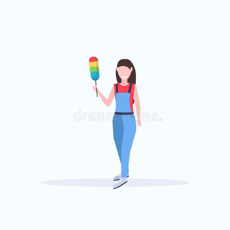 Female janitor in uniform holding dust brush woman cleaner dusting cleaning service concept full length flat white vector illustration