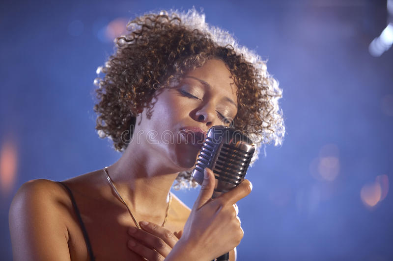 Female Jazz Singer On Stage. Closeup of a female jazz singer on stage royalty free stock photos