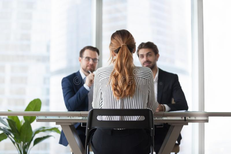Female job candidate interview with doubting employers stock photo