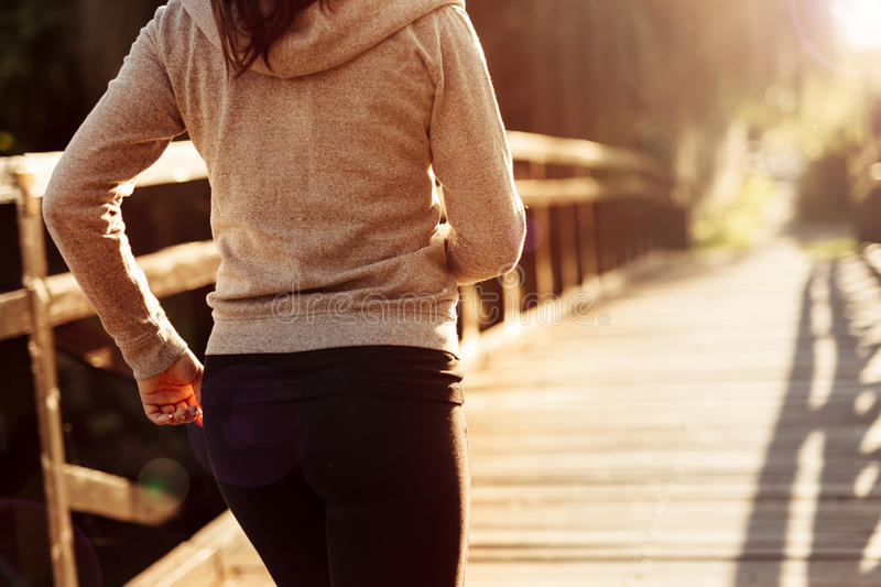 Female jogger exercising outdoors. In nature royalty free stock images