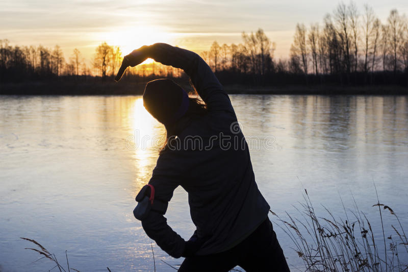 Female jogger in the morning stock photography