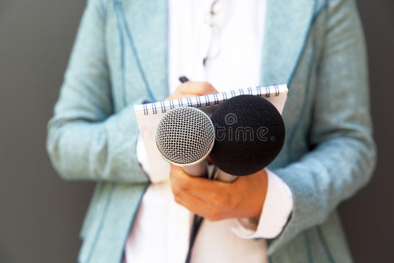 Journalist at press or news conference royalty free stock photo
