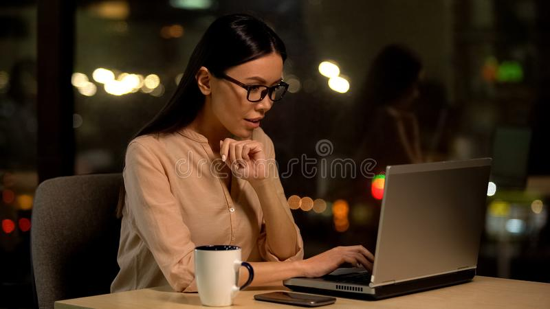Female journalist typing article, cup of coffee on table, work inspiration. Stock photo stock photo