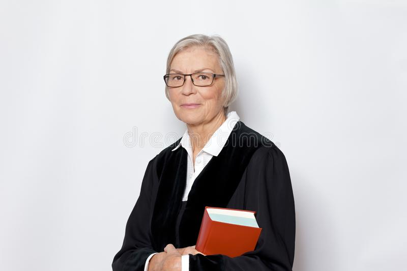 Female judge magistrate black gown stock photography