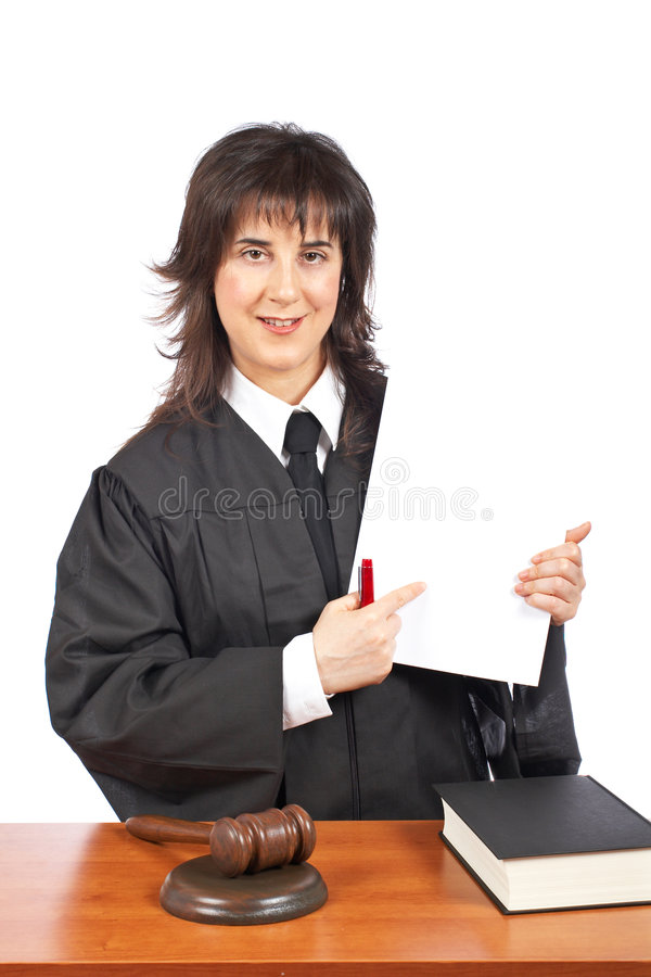Female judge points to blank court order. A female judge points to blank court order, over a white background. Shallow depth of field royalty free stock photo