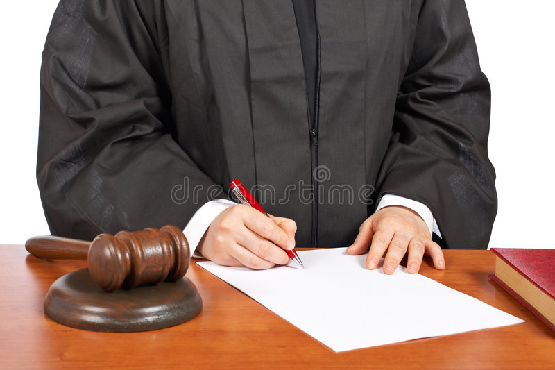 Female judge sign to blank court order. A female judge sign to blank court order, over a white background. Shallow depth of field royalty free stock image