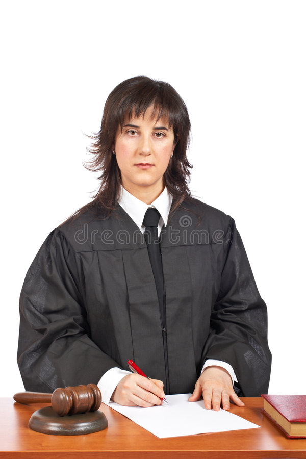 Female judge sign to blank court order. A female judge sign to blank court order, over a white background. Shallow depth of field royalty free stock images