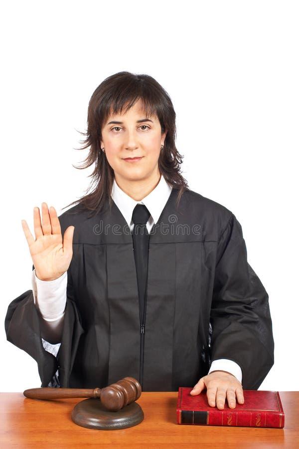 Female judge taking oath stock image