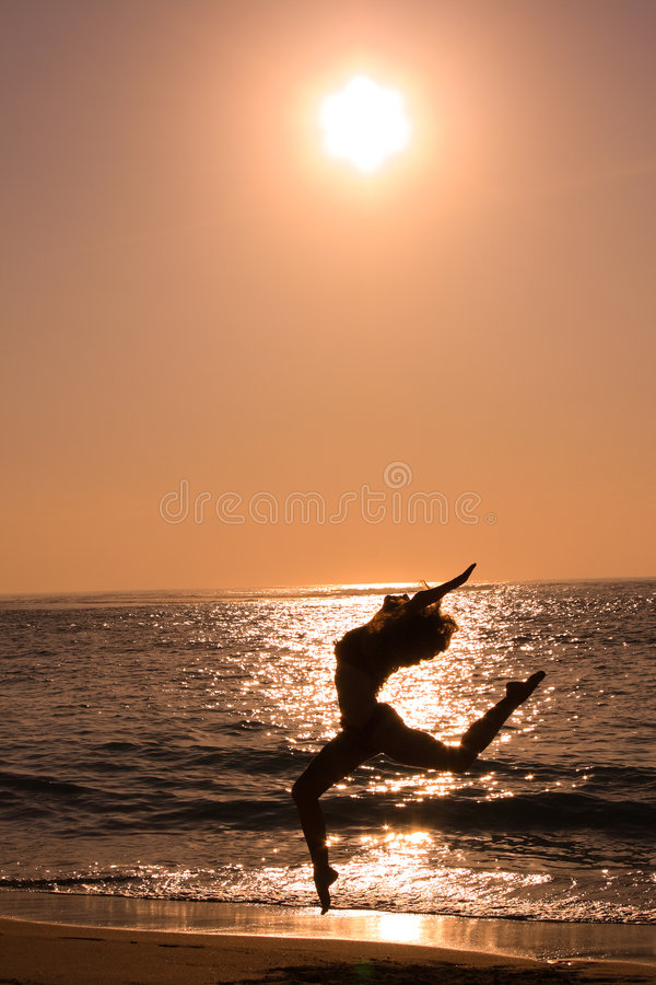 Female jumping at beach stock photos