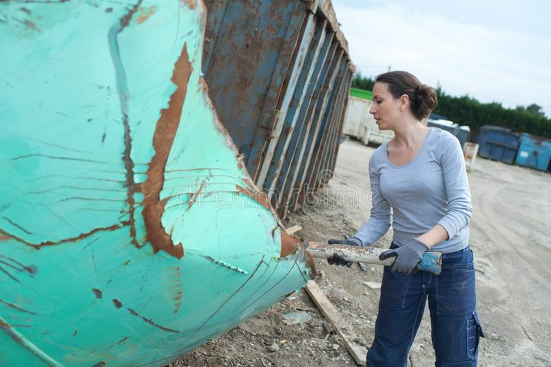 Female junk yard worker royalty free stock image