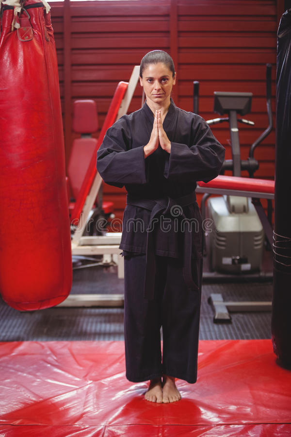Female karate player performing karate stance stock image