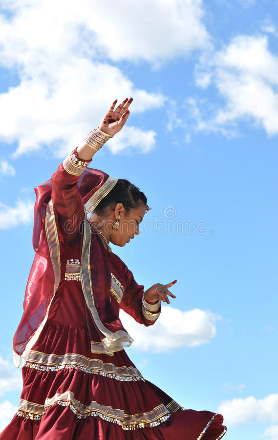 Female Kathak Dancer. A young woman performing a traditional kathak dance at Edmonton's Heritage festival stock photo