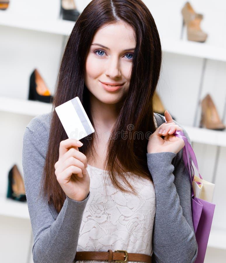 Female keeps credit card in footwear shop