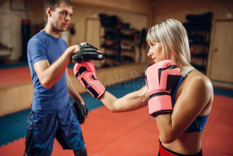 Female kickboxer practicing hand punch stock photos