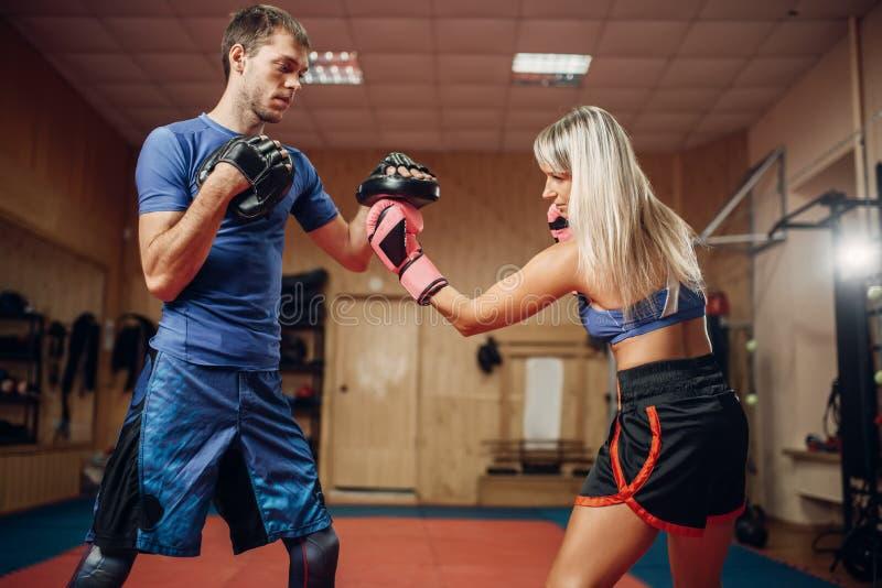 Female kickboxer practicing hand punch stock photo