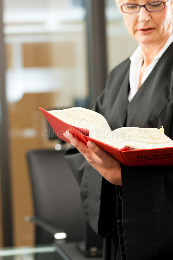 Female Lawyer With German Civil Code Stock Photos