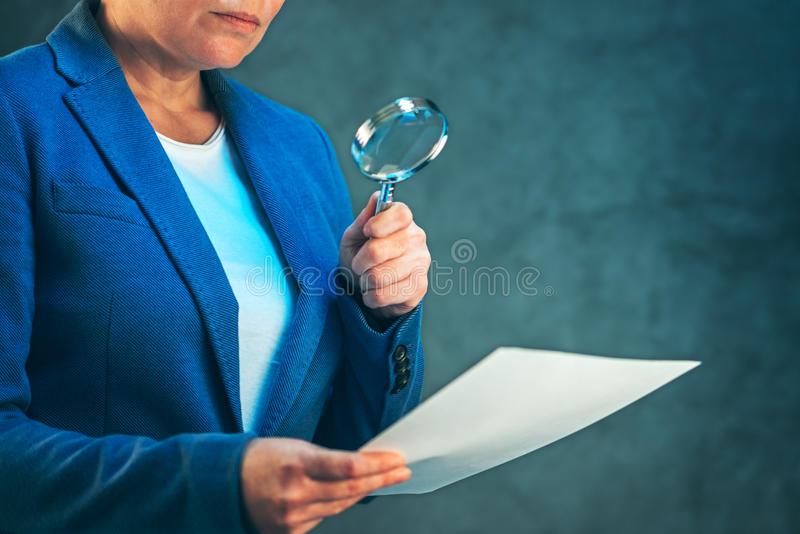 Female lawyer reading legal contract agreement disclaimer with m royalty free stock photo