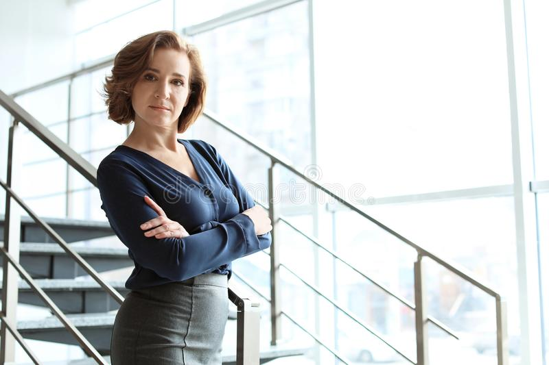 Female lawyer standing near stair. S in office stock images