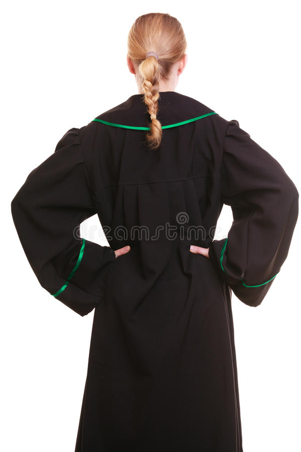 Female lawyer wearing classic polish black green gown back view. Law court or justice concept. Back view of woman lawyer attorney wearing classic polish (Poland stock photo