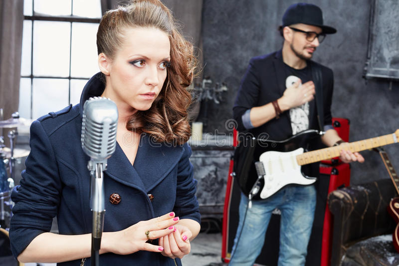 Female lead vocal and guitarist royalty free stock images