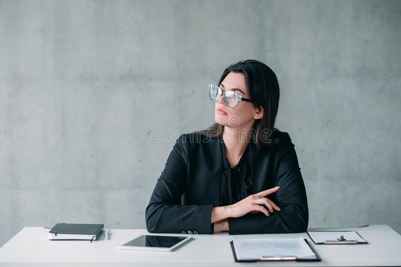 Female leader career successful business woman. Female leader. Successful professional career. Confident business woman in eyeglasses with thoughtful facial royalty free stock image