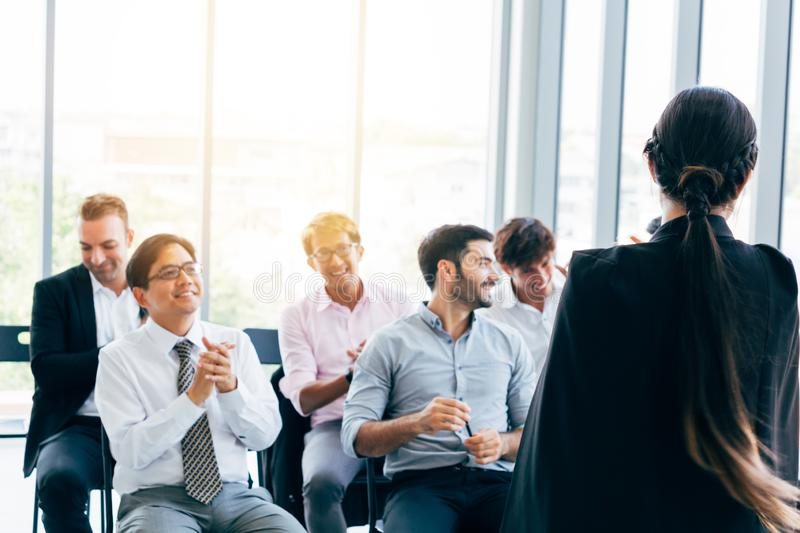 Female leader doing presentation for coworkers stock photography