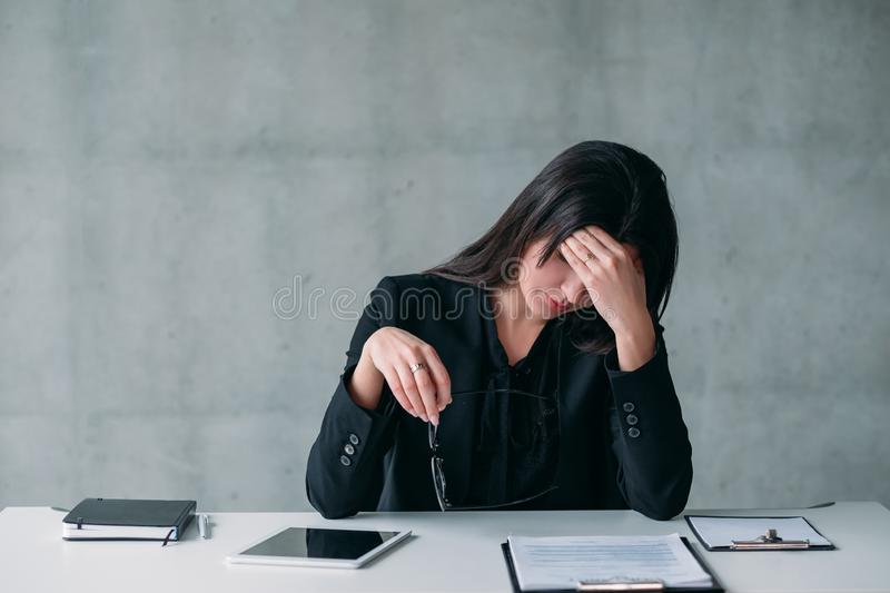 Female leader career stressed out business woman. Female leader. Exhausting job and modern professional life. Stressed out business woman taking a break royalty free stock photography